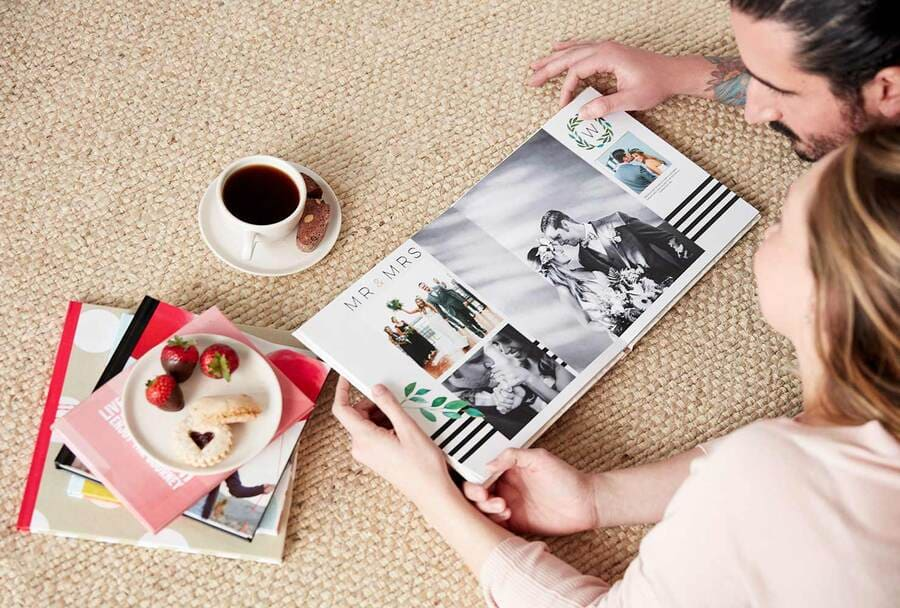 couple browsing through their personalized wedding photo book together