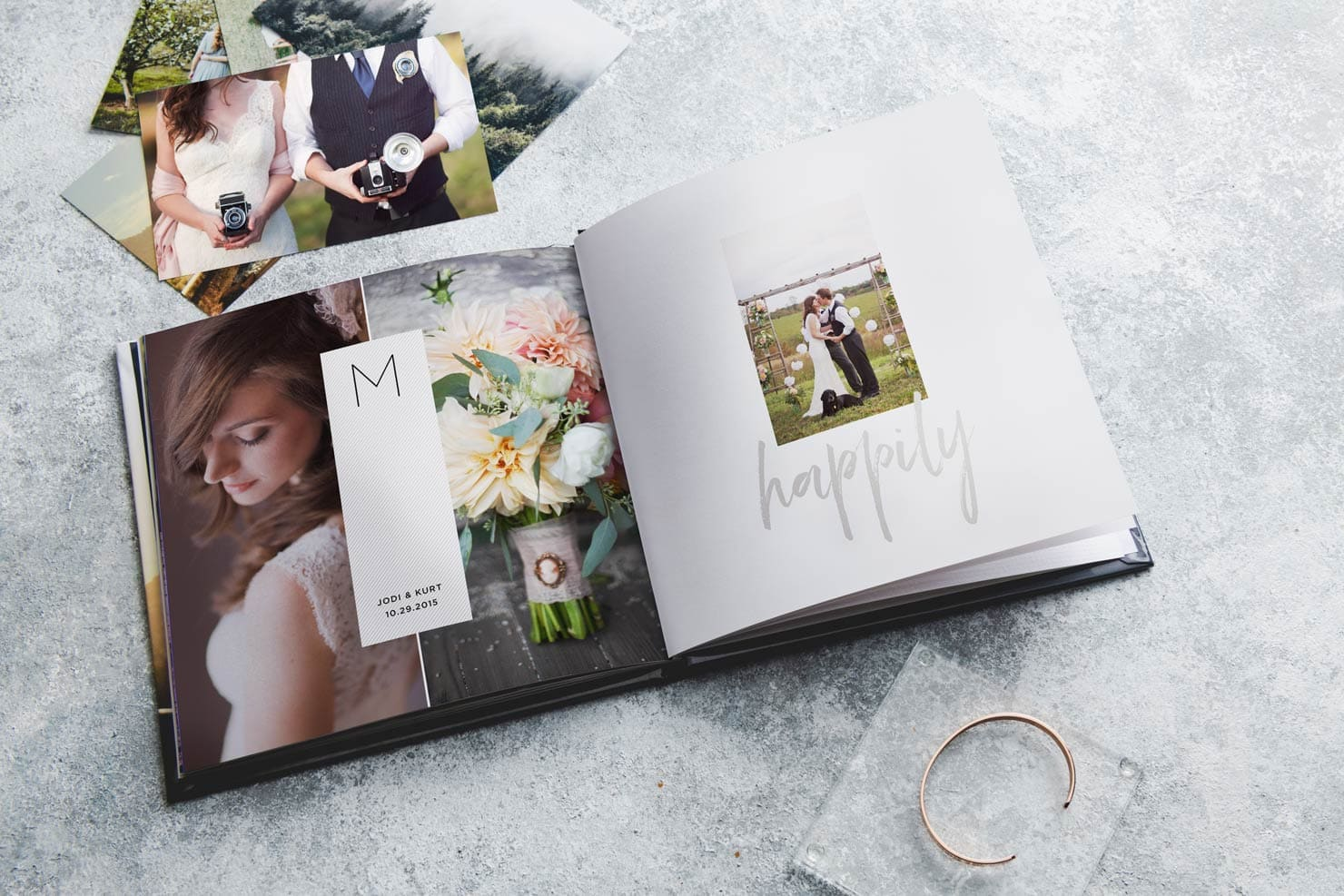 modern wedding album layflat on table with personalized captions